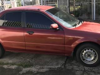 '02 Mazda 323 for sale in Jamaica