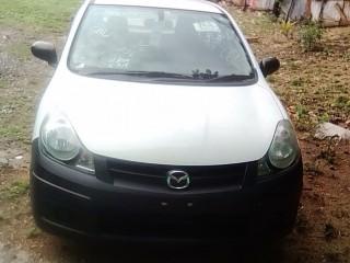 '13 Mazda Familia for sale in Jamaica