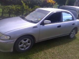 '97 Mazda Familia for sale in Jamaica