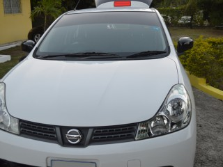 '11 Nissan Wingroad for sale in Jamaica