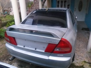 1999 Mitsubishi Lancer NO PAPERS SELLING AS IS FOR SCRAP for sale in St. James, Jamaica