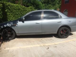 '96 Mazda Familia for sale in Jamaica